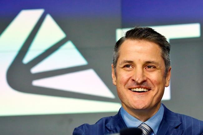 Brendan Kennedy, CEO and founder of British Columbia-based Tilray Inc., poses next to his company's logo at Nasdaq where the company's IPO (TLRY) opened, Thursday, July 19, 2018, in New York. THE CANADIAN PRESS/AP/Bebeto Matthews