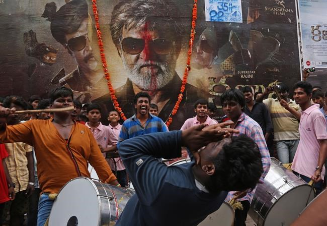 Holiday in parts of India as fans revel in Rajinikanth ...