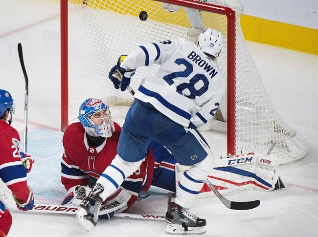 Toronto Maple Leafs  Connor Brown scores against Montreal Canadiens  goaltender Charlie Lindgren during third period NHL hockey action in  Montreal 165cece09