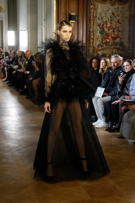424038f6 A model wears a creation as part of the Elie Saab ready to wear Fall-Winter  2019-2020 collection, that was presented in Paris, Saturday, March 2, 2019.