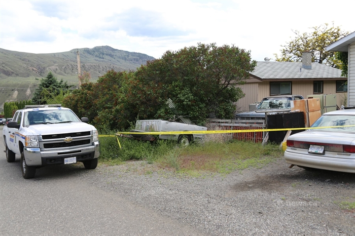 Police tape surrounds a home at 602 Cedar Street in Ashcroft where a body was found June 2, 2014.