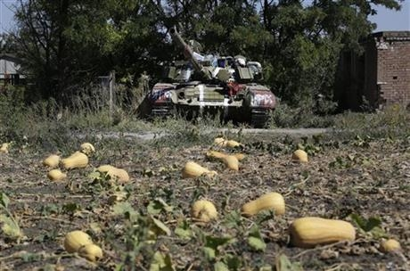 An abandoned Ukrainian army tank is seen in the village of Kominternove , Ukraine, Saturday, Sept. 6, 2014.