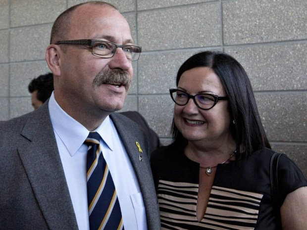 Ric McIver and his wife Christine speak to media before the results of the Progressive Conservative leadership first ballot in Edmonton on Saturday, Sept. 6, 2014.