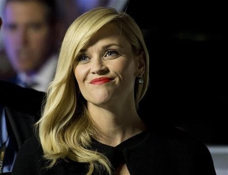 Reese Witherspoon poses for photographs on the red carpet for the movie