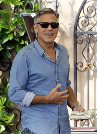 George Clooney walks in the garden of the Cipriani hotel in Venice, Italy, Saturday, Sept. 27, 2014.