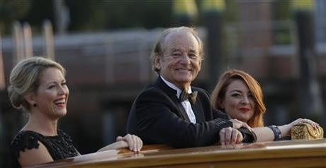 Actor Bill Murray smiles from a boat prior to the George Clooney and Alma Amal Alamuddin wedding in Venice, Italy, Saturday, Sept. 27, 2014.