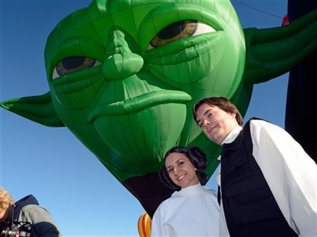 Amber and Nate Hoffman dressed as Princess Leia and Han Solo during the unveiling of the new Yoda balloon at the annual Albuquerque International Balloon Fiesta in Albuquerque, N.M. Saturday, Oct. 4, 2014.