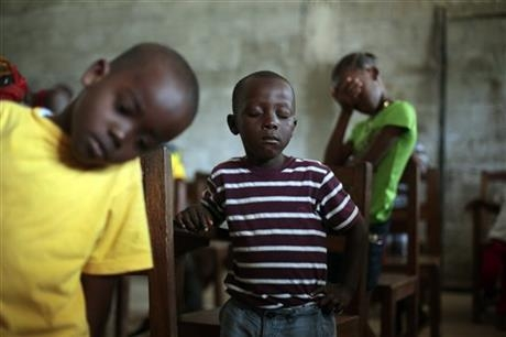 Children pray during Sunday service at the Bridgeway Baptist Church in Monrovia, Liberia.