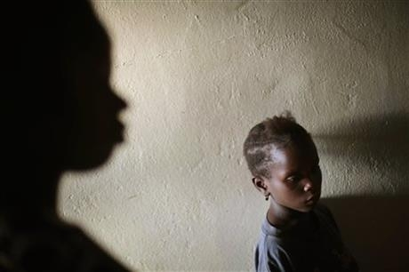Miamu Saryon, 7, stands in the hallway of Mawah clinic downtown Monrovia, Liberia.