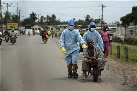 Residents of the St. Paul Bridge neighbourhood take a man suspected of carrying the Ebola virus to the Island Clinic.