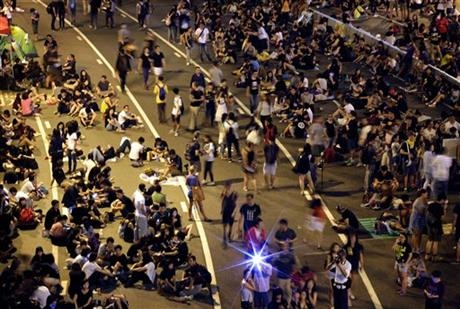 Student pro-democracy protesters continue to occupy the streets near government headquarters, Sunday, Oct. 5, 2014 in Hong Kong.
