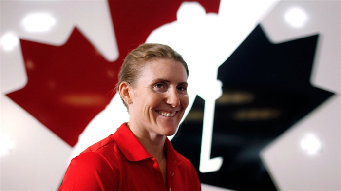 Canadian National Women's hockey player Hayley Wickenheiser at a news conference in Calgary, Monday, May 27, 2013.