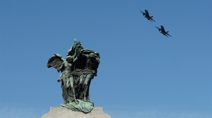 CF-18 jets fly over the National War Memorial during the Remembrance Day ceremony in Ottawa on Tuesday, Nov. 11, 2014.