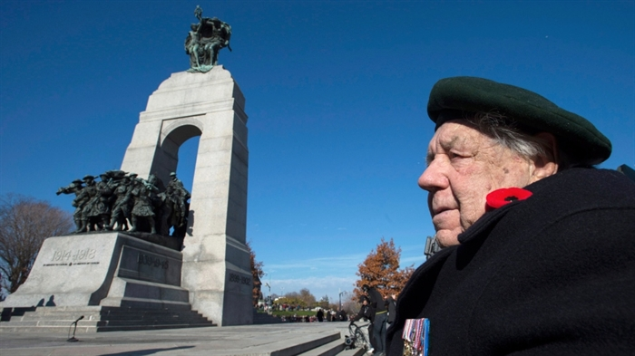 Second World War veteran Ted Patrick looks on before the start of the Remembrance Day ceremony at the National War Memorial in Ottawa on Tuesday, Nov. 11, 2014.