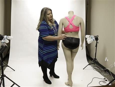 Jessica Asmar, owner of Feel Foxy, repositions a mannequin wearing a pair of padded panties.