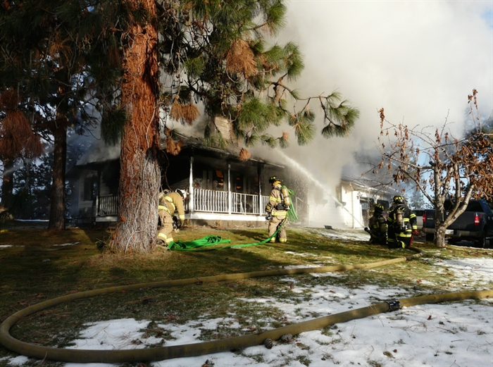 Kelowna firefighters working a house fire at 2642 Monford Road in north Glenmore, Sunday, Nov. 30, 2014.