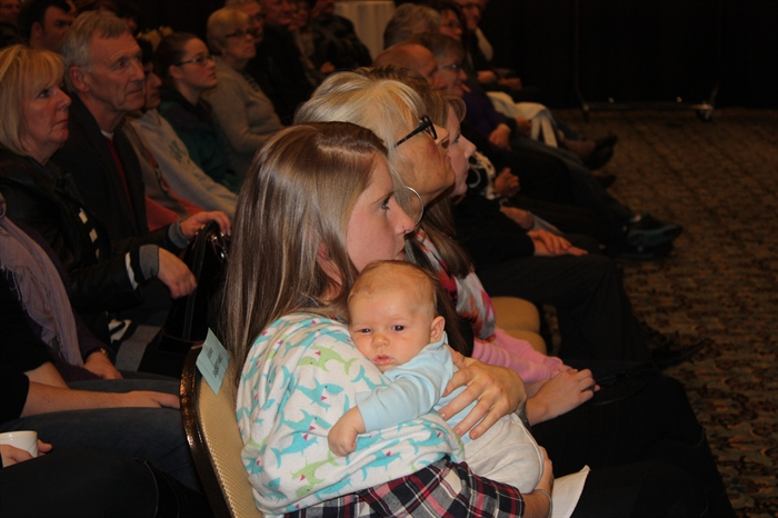 Monday's Penticton council inauguration seems to be a little more than sleepy eyed Hawksley Carlson can handle. Shown in mother Ronnie Nickel's arms, Hawksley is Mayor Jakubeit's grandson.
