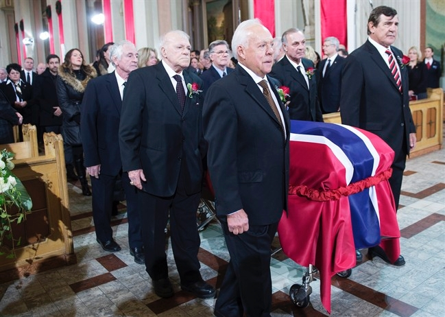 Pallbearers and former teammates (left tor right) Dickie Moore, Jean-Guy Talbot, Phil Goyette, Yvan Cournoyer, Guy Lafleur and Serge Savard carry the casket of former Montreal Canadiens captain Jean Beliveau into his funeral service at Mary Queen of the World Cathedral in Montreal, Wednesday, Dec.10, 2014.