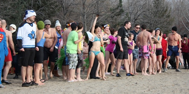 Getting ready to take the icy plunge in Okanagan Lake at Summerland, Thursday, Jan. 1, 2015.