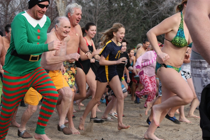 Participants in Summerland Kinsmen's 30 annual polar bear dip race for Okanagan Lake on Thursday, Jan. 1, 2015.