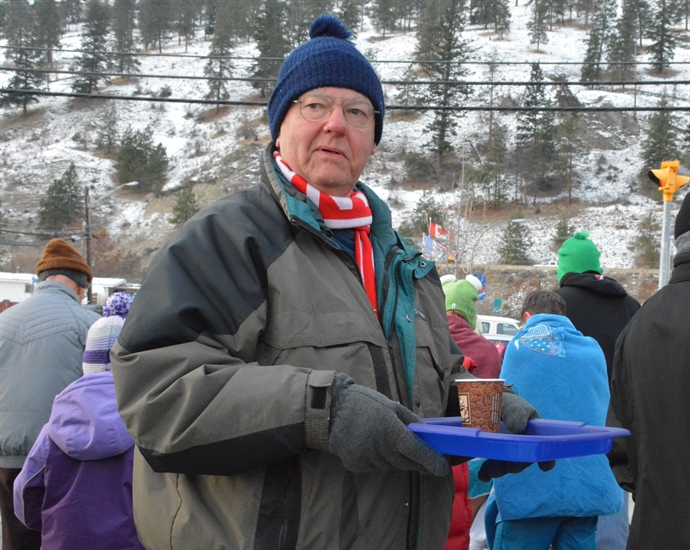 Volunteers were on hand to dispense cups of hot chocolate following the Polar Bear Swim in Peachland, January 1, 2015.