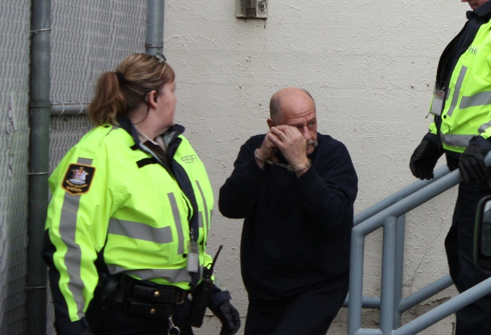 Pier Louis Robotti is led out of Penticton courthouse after a brief appearance Thursday.