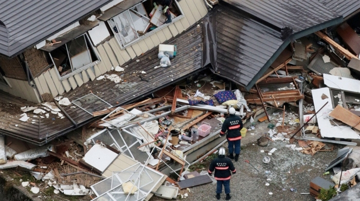 This aerial photo shows collapsed houses after a strong earthquake hit Hakuba, Nagano prefecture, central Japan, Sunday, Nov. 23, 2014.