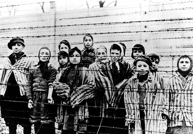 A photo taken just after the liberation by the Soviet army shows a group of children wearing concentration camp uniforms at the Auschwitz Nazi concentration camp on January 27, 1945. Miriam Friedman Ziegler, nine-years-old at the time, is second from left. Friedman Ziegler, who lives in Thornhill, Ont., is among about 100 survivors who are returning to Poland this week to commemorate the 70th anniversary of the liberation of Auschwitz.
