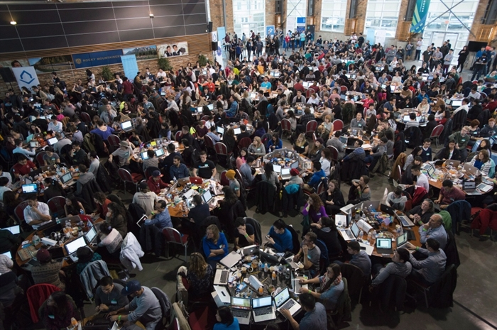 Participants jam into a giant lecture hall in Vancouver, B.C. Saturday, Jan. 24, 2015 to take part in HTML500, a course which teaches computer coding skills.