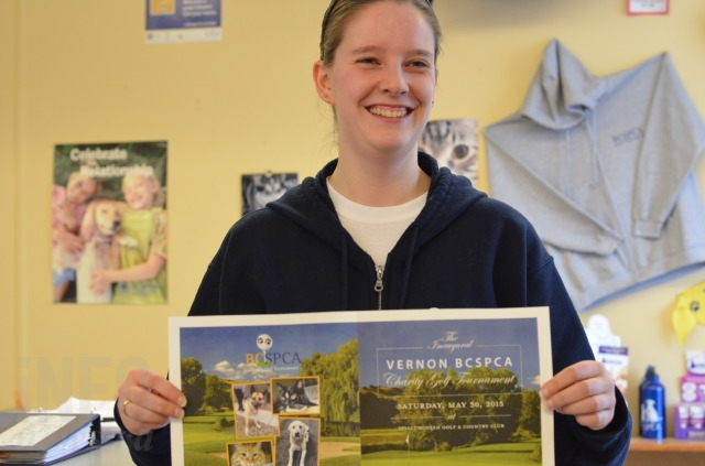 Vernon branch manager Chelsea Taylor holds a poster for the upcoming Vernon B.C. SPCA Charity Golf Tournament in May.