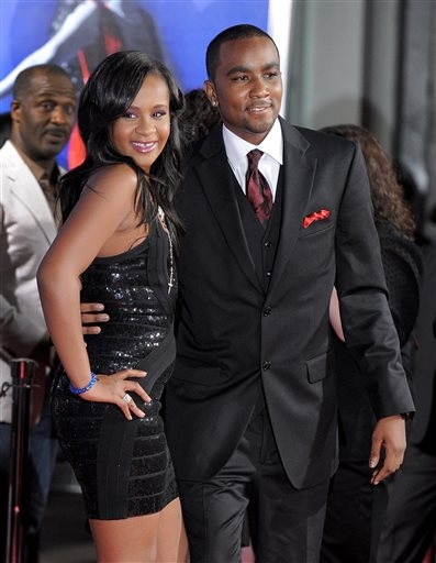 In this Aug. 16, 2012 file photo, Bobbi Kristina Brown, right, and Nick Gordon attend the Los Angeles premiere of