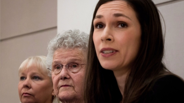 From left to right, Gloria Taylor's sister Patty Ferguson, of Edmonton, Alta., her 85-year-old mother Anne Fomenoff, of Castlegar, B.C., and B.C. Civil Liberties Association litigation director Grace Pastine attend a news conference in Vancouver, B.C., on Sunday March 3, 2013.