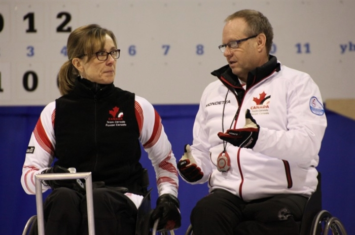 Vernon's Sonja Gaudet and Dennis Thiessen from Sanford, Man. discuss strategy at the World Wheelchair Curling Championships in Finland, Saturday, Feb. 7, 2015.
