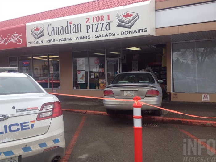 A car jumped the sidewalk and crashed through a storefront at 700 Tranquille Road in Kamloops, February 10, 2015.