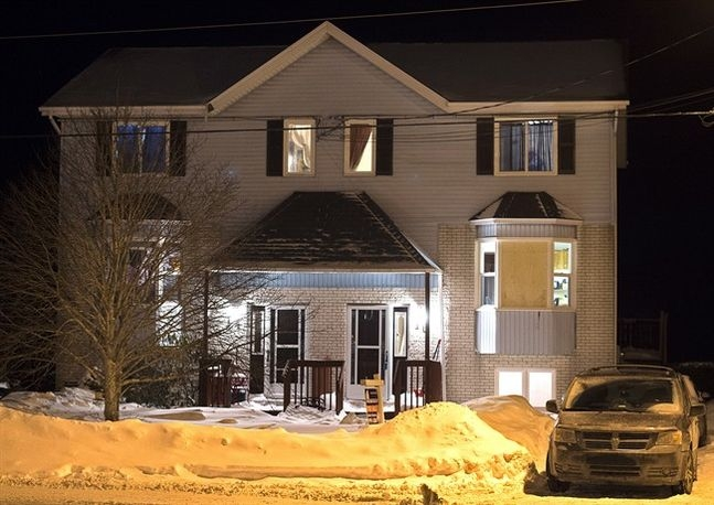 A house is seen on Tiger Maple Drive in Timberlea, N.S, a Halifax suburb, where police found a deceased person early Friday, Feb. 13, 2015. RCMP issued a statement on saying the 19-year-old man who was found dead had intentions go to a public place with a woman and open fire on citizens before killing themselves on Valentine's Day. Three people have been arrested.