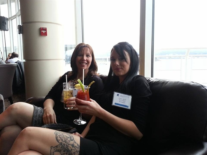 Mel and Brittany of Mel's Pizza at the Pan Pacific Hotel in Vancouver celebrating their win, Thursday, Feb. 26, 2015. The business won the Best Workplace award at the B.C. Small Business Awards.
