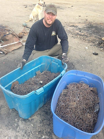 Calvin Fedechko shows all the nails collected at the site.