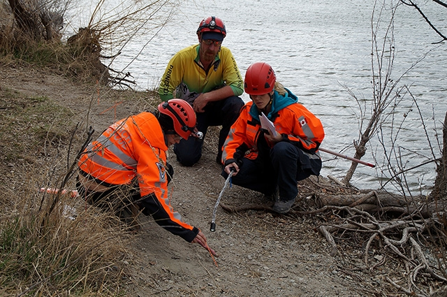 Teams identify tracks and find tracks to indicate direction of travel. Shown, left to right: Sil Huber (PENSAR), Scott Hare (Princeton Search and Rescue) and Christy Giles (PENSAR).