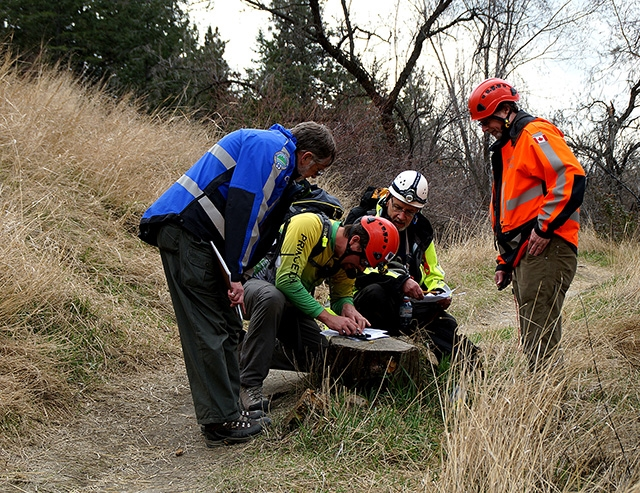 Teams navigate a course while searching for clues. Left to right in photo:  Stan Wieczorak (COSAR), Pete Vangene (Princeton), Jim Barrett (Princeton) and Fraser McKinnon (PENSAR).