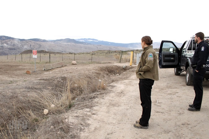 Amanda Weber-Roy and Rob Armstrong survey the area where someone on an ATV ignored several barriers to protect the grasslands. But that's not the only problem in the park