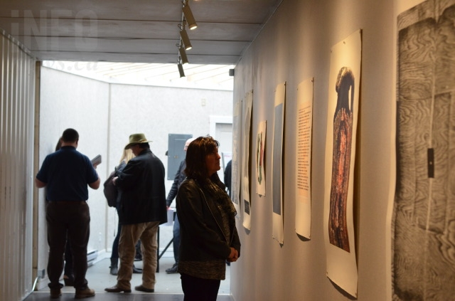 A variety of print works are hung inside the BigSteelBoxes at the corner of 31 Street and 31 Avenue.