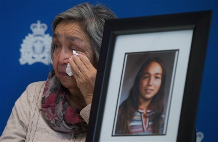 Madeline Lanaro, whose daughter Monica Jack was 12-years-old when she was murdered in 1978 near Merritt, B.C., wipes away tears after the RCMP announced an arrest in connection to her murder and that of Kathryn-Mary Herbert, during a news conference in Surrey, B.C., on Monday December 1, 2014.