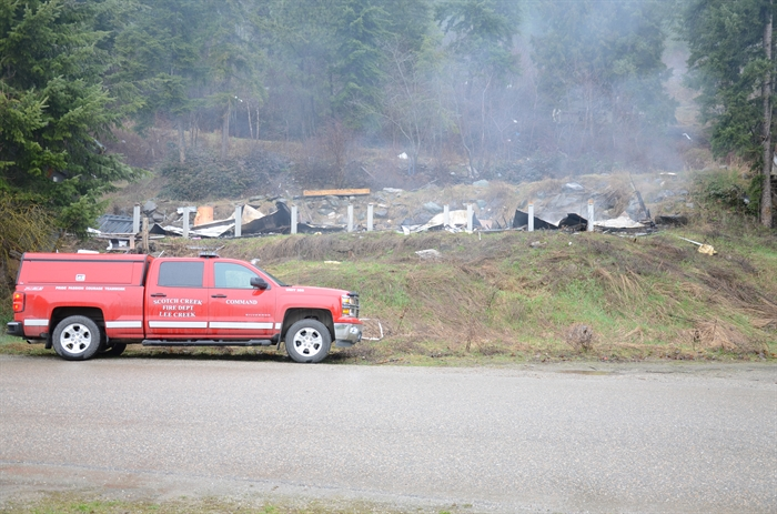 The morning after a fire burned an abandoned mobile home on Butters Road in Scotch Creek, Friday, March 20, 2015.