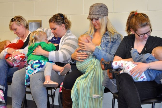 Breast-feeding mothers inside West Kelowna council chambers.