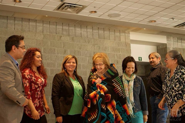 Tk'emlúps te Secwepemc chief and council present Coun. Pat Wallace with a blanket to commemorate her.