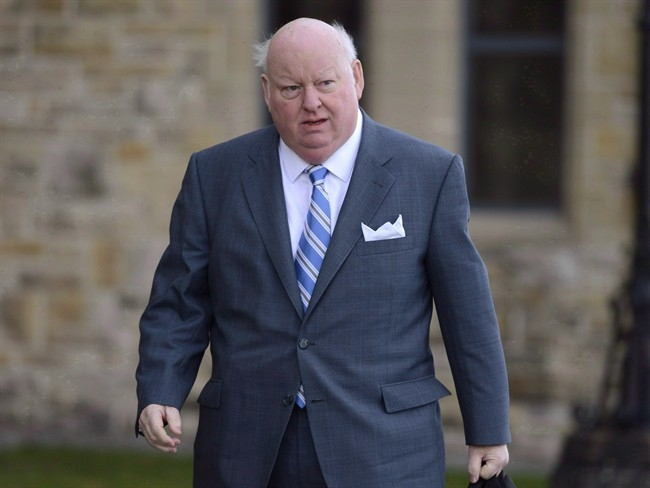 Mike Duffy is shown arriving at the Senate in Ottawa, Monday, October 28, 2013.