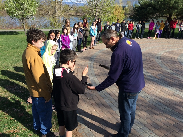 Students participate in a smudging ceremony.