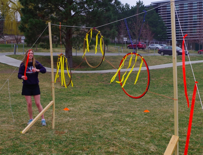 Player Katie Bieber sets up the bike tire hoops on the makeshift quidditch field
