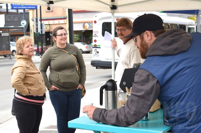 Andrew McWilliam serves a cup of coffee out of his mobile Ratio Coffee food truck outside the pop-up Vernon art gallery on 31 Avenue.