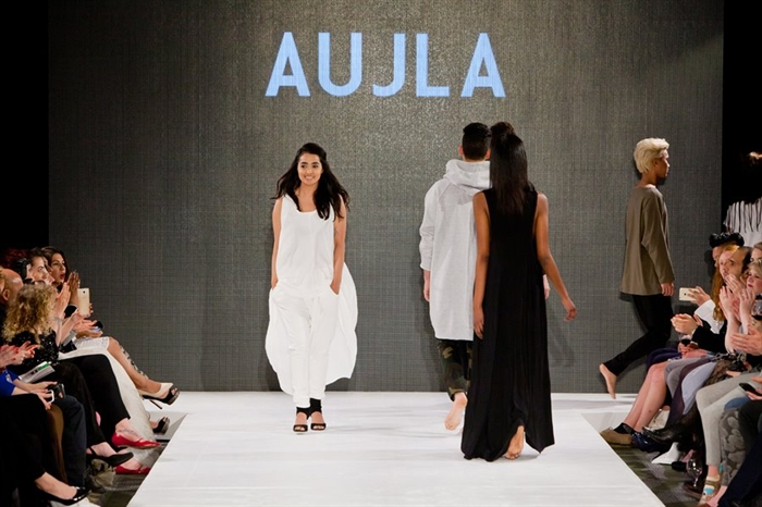 Raji Aujla walks onstage at the close of her show at Eco-Fashion Week in Vancouver.